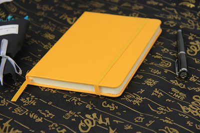 Custom yellow leather notebook can be used for office, business writing in EECA